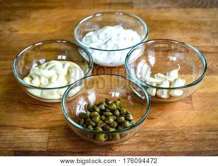 Different Ingredients For Homemade Tartar Sauce On Wooden Desk.