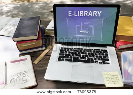 Pile of books laptop with book sign