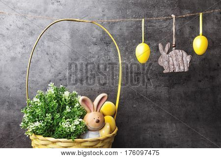 Easter Eggs And Bunnies On Hanging On Rustic Background