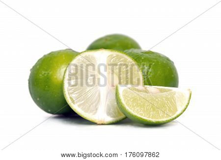 Lemon Or Lime Fruit With Half Cross Section And Partial Section Isolated On White