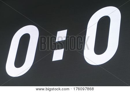 Outdoor LED panels on the stadium. Black scoreboard stadium shows white 0 : 0 at the beginning of the soccer or football match.