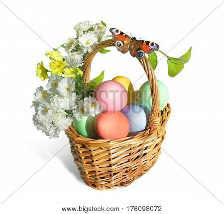 Easter basket. An orange butterfly sits on the handle of a wicker basket. The basket is full of colorful eggs and flowers. Isolated on white