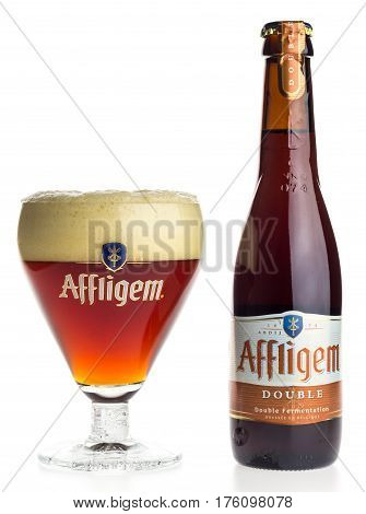 GRONINGEN, NETHERLANDS - MARCH 10, 2017: Bottle and glass of Belgian Affligem Double beer isolated on a white background