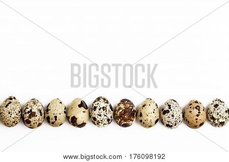 Quail Eggs To The Bottom On A White Background