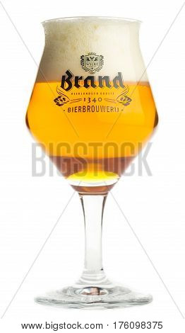GRONINGEN, NETHERLANDS - MARCH 12, 2017: Glass of Dutch Brand IPA beer isolated on a white background