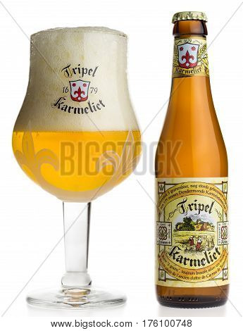 Bottle and glass of Tripel Karmeliet beer isolated on a white background
