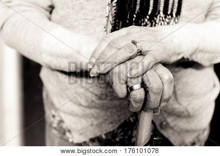 Old Woman's Hands On Umbrella Handle. Black And White.