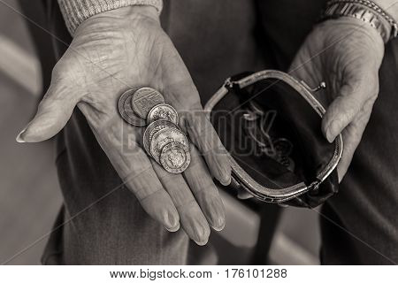 British Coins In The Hand Of A Pensioner.