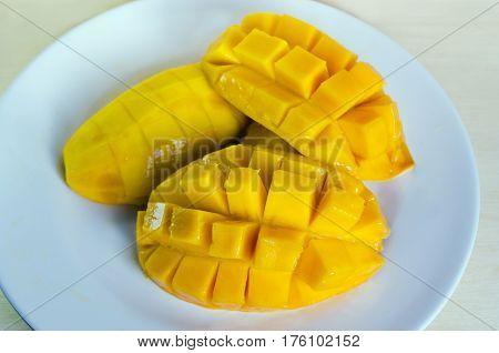 Mango Fruiton The Dish Sliced And  Isolated On Wood Background