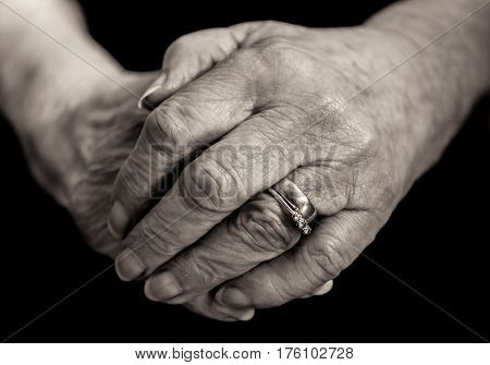 Monochrome Close Up Of An Elderly Married Lady's Hands.