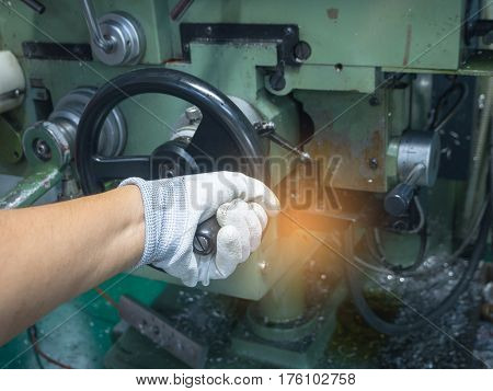 Hand of man using control function milling machine.