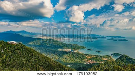 Panoramic view of blue sky sea and mountain seen from Cable Car viewpoint, Langkawi Island, Malaysia.Picturesque landscape with beaches, small Islands and tourist ships at waters of Strait of Malacca.