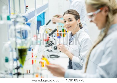 Scientist Working With Microscope