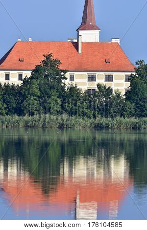 Castle Chropyne in Moravian part of Czech republic with its mirror image reflection.