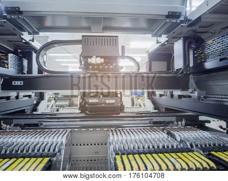 Machine running on process for insert part electronics.