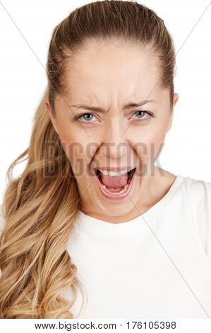 Portrait of  young attractive  angry  blonde  isolated on white background.