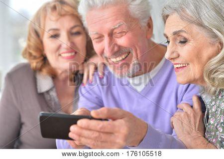 Portrait of elderly people using mobile phone