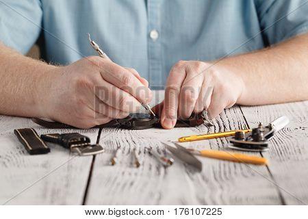 man hands repaire clock handmade changing watchband
