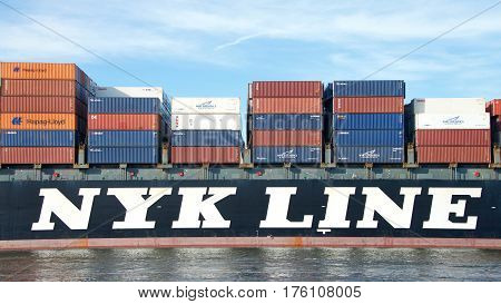 Oakland CA - March 07 2017: Cargo ship NYK ATHENA entering the Port of Oakland. Nippon Yusen Kabushiki Kaisha (NYK) is one of the oldest and largest shipping companies in the world.
