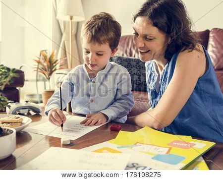 Mom Teaching Her Son Doing Homework