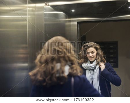 Woman entering the elevator