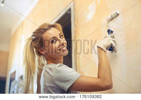 Girl doing renovation works