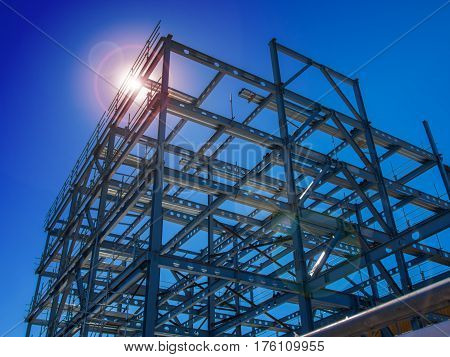 New steel building construction with sun flare
