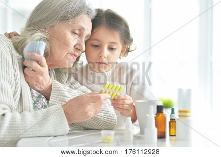 Portrait of a granddaughter takes care of a sick grandmother