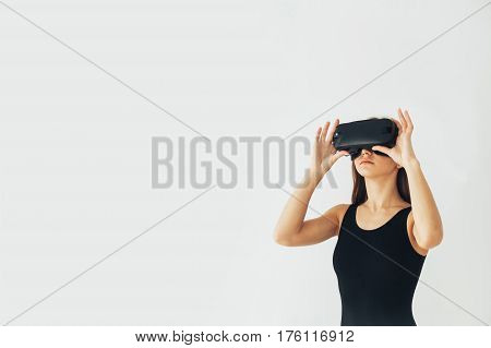 Sport athlete girl with a beautiful figure with glasses of virtual reality. Future technology concept. Modern imaging technology. Conceptual image of virtual sports. Sports simulator.
