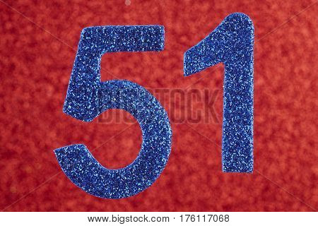 Number fifty-one glitter blue over a red background. Anniversary. Horizontal