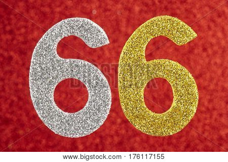 Number sixty-six glitter silver and gold over a red background. Anniversary.