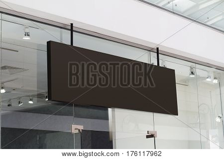 horizontal black empty signage on clothes shop front with glass windows poster