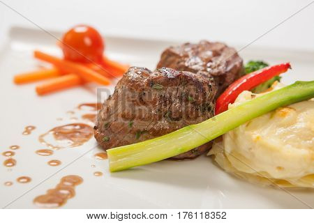 Medallions Of Grilled Veal With Gratin Potatoes Close Up