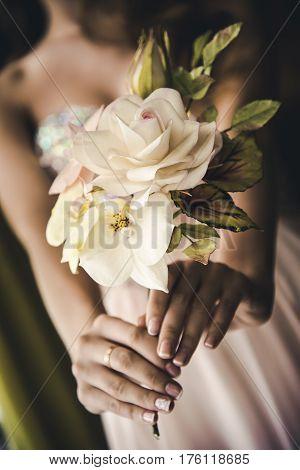 Bride  holding  white rose wedding flowers bouquet.