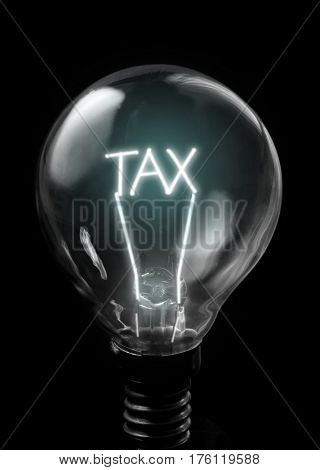 Tax lit up inside bulb on a black background