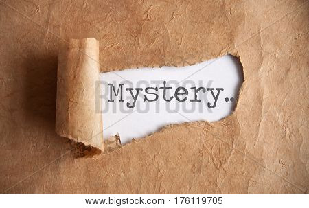 Torn piece of scroll uncovering the word mystery