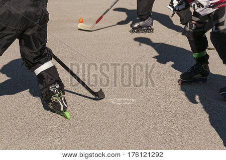 four players are all pursuing the puck