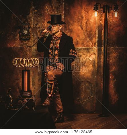 Steampunk man with Tesla coil on vintage steampunk background.