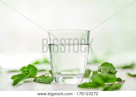 Glass Of Water With Fresh Mint On Table