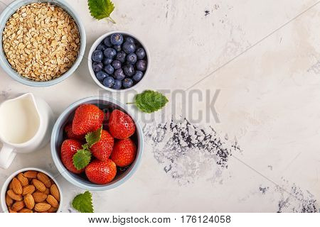 Healthy Breakfast - A Bowl Of Oatmeal, Berries And Fruit, Top View.