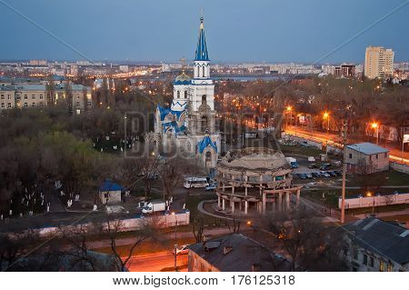 Evening Voronezh from rooftop. View to memorial of destroyed and Rotunda and Church of Equal to the Apostles Vladimir