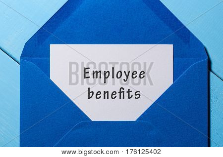 EMPLOYEE BENEFITS , Business Concept, text written at letter in blue envelope.