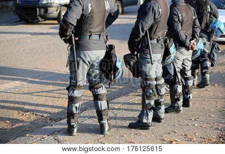 Police In Riot Gear With Flak Jackets And Protective Helmets And