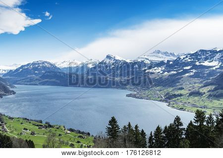 Lake Lucerne landscape with snow covered mountains in the background taken from the Buergenstock mountain resort