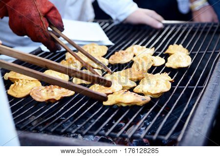 Traditional smoked sheep cheese on the grill