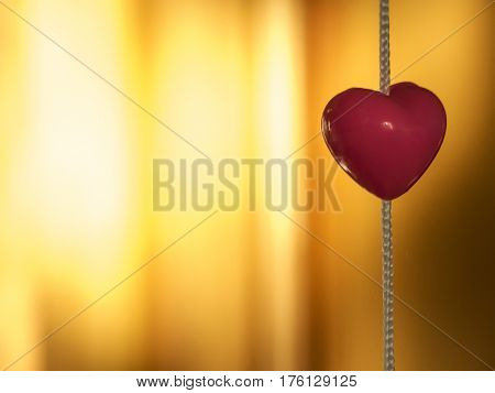 Beauty pink toy heart on the light background