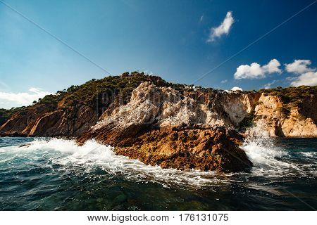 View Of The Coastal Cliff With Gulls From The Open Sea