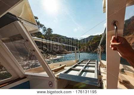 View Of The Coastal Bay From The Side Of The Pleasure Boat Through The Railing Of The Gangway
