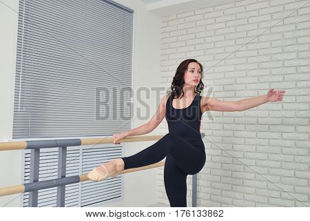 Beautiful women dancer practicing ballet at dancing studio.
