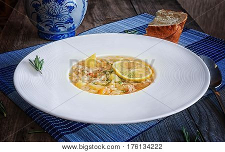 chicken soup on a white plate with spices